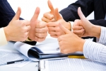 People with their thumbs up meaning a great business plan - Объединение профсоюзов